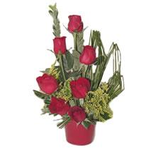 Artvin çiçekçi mağazası  minik vazoda 7 adet kirmizi gül